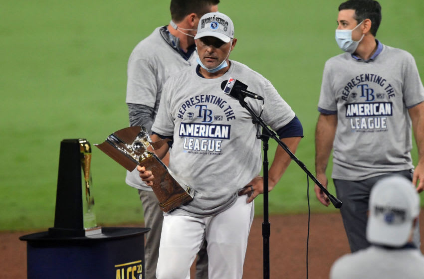 Oct 17, 2020; San Diego, California, USA; Tampa Bay Rays manager Kevin Cash with the American League trophy following game seven of the 2020 ALCS against the Houston Astros at Petco Park. Mandatory Credit: Jayne Kamin-Oncea-USA TODAY Sports
