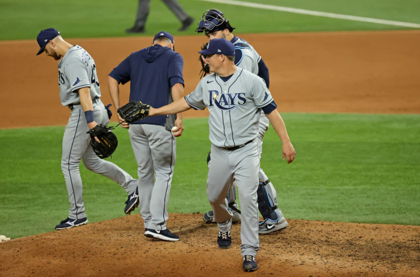 Oct 21, 2020; Arlington, Texas, USA; Tampa Bay Rays relief pitcher Aaron Loup (15) leaves the game in the 9th inning against the Los Angeles Dodgers in game two of the 2020 World Series at Globe Life Field. Mandatory Credit: Kevin Jairaj-USA TODAY Sports