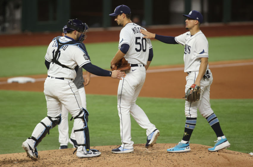 Tampa Bay Rays starting pitcher Charlie Morton (50) reacts with members of the infield as he is removed from the game against the Los Angeles Dodgers during the fifth inning of game three of the 2020 World Series at Globe Life Field. Mandatory Credit: Tim Heitman-USA TODAY Sports