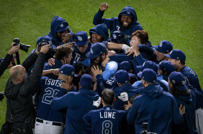 The Tampa Bay Rays celebrate right fielder Brett Phillips (14) hitting the game winning walk off single against the Los Angeles Dodgers during the ninth inning in game four of the 2020 World Series at Globe Life Field. Mandatory Credit: Jerome Miron-USA TODAY Sports