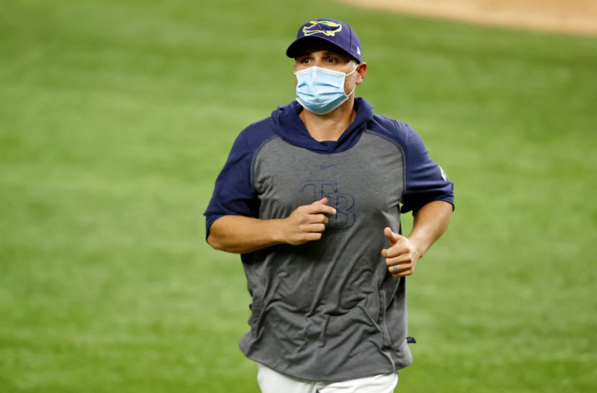 Oct 25, 2020; Arlington, Texas, USA; Tampa Bay Rays manager Kevin Cash (16) jogs off the field after a pitching change against the Los Angeles Dodgers during the sixth inning during game five of the 2020 World Series at Globe Life Field. The Los Angeles Dodgers won 4-2. Mandatory Credit: Tim Heitman-USA TODAY Sports