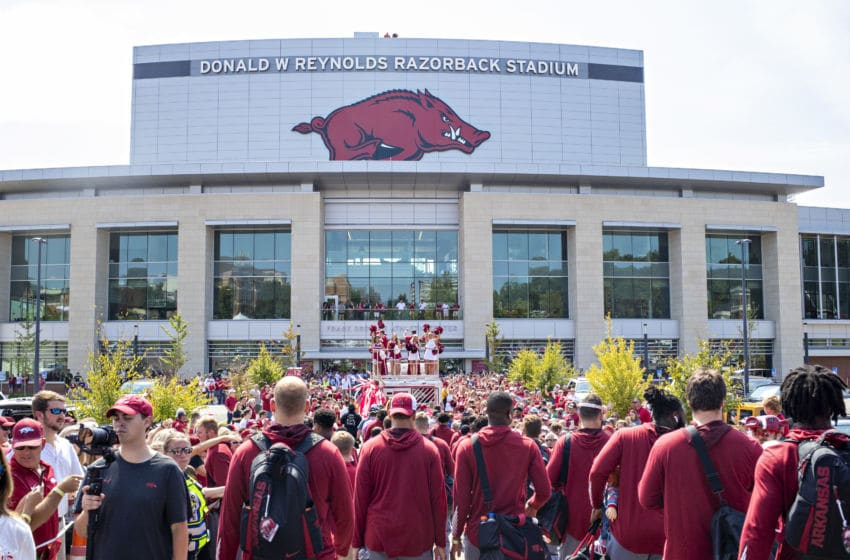FAYETTEVILLE, AR - SEPTEMBER 14: Arkansas Razorback football team walks to the stadium and greets fans before a game against Colorado State Rams at Razorback Stadium on September 14, 2019 in Fayetteville, Arkansas. (Photo by Wesley Hitt/Getty Images)