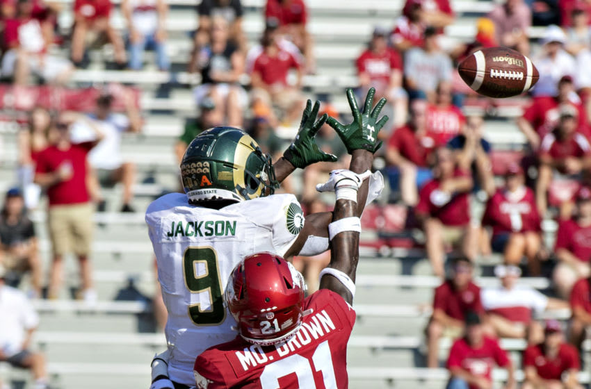 FAYETTEVILLE, AR - SEPTEMBER 14: Warren Jackson #9 of the Colorado State Rams has a pass knocked away by Montaric Brown #21 of the Arkansas Razorbacks at Razorback Stadium on September 14, 2019 in Fayetteville, Arkansas. (Photo by Wesley Hitt/Getty Images)