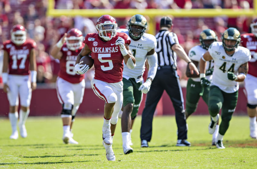 FAYETTEVILLE, AR - SEPTEMBER 14: Rakeem Boyd #5 of the Arkansas Razorbacks runs the ball during a game against the Colorado State Rams at Razorback Stadium on September 14, 2019 in Fayetteville, Arkansas. The Razorbacks defeated the Rams 55-34. (Photo by Wesley Hitt/Getty Images)