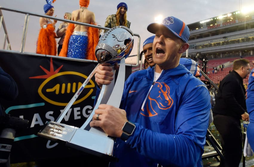 LAS VEGAS, NV - DECEMBER 16: Head coach Bryan Harsin of the Boise State Broncos celebrates with the trophy after the Broncos defeated the Oregon Ducks in the Las Vegas Bowl at Sam Boyd Stadium on December 16, 2017 in Las Vegas, Nevada. Boise State won 38-28. (Photo by David Becker/Getty Images)