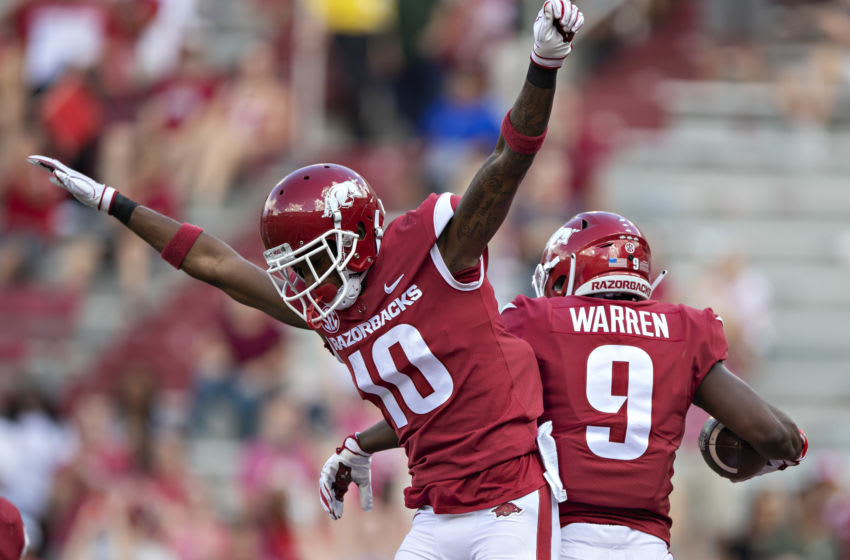 FAYETTEVILLE, AR - OCTOBER 6: De'Vion Warren #9 celebrates after catching a touchdown pass with Jordan Jones #10 of the Arkansas Razorbacks in the second half during a game against the Alabama Crimson Tide at Razorback Stadium on October 6, 2018 in Tuscaloosa, Alabamai. The Crimson Tide defeated the Razorbacks 65-31. (Photo by Wesley Hitt/Getty Images)