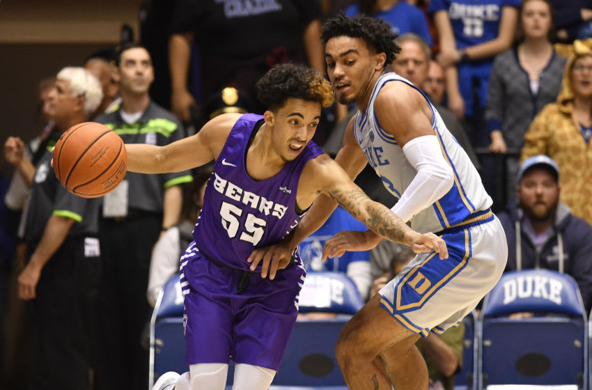 DURHAM, NORTH CAROLINA - NOVEMBER 12: DeAndre Jones #55 of the Central Arkansas Bears drives against Tre Jones #3 of the Duke Blue Devils during the first half of their game at Cameron Indoor Stadium on November 12, 2019 in Durham, North Carolina. (Photo by Grant Halverson/Getty Images)