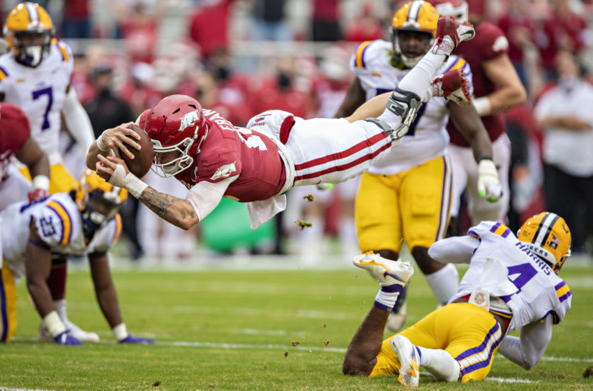 FAYETTEVILLE, AR - NOVEMBER 21: Feleipe Franks #13 of the Arkansas Razorbacks dives into the end zone for a touchdown in the first half of a game against the LSU Tigers at Razorback Stadium on November 21, 2020 in Fayetteville, Arkansas. (Photo by Wesley Hitt/Getty Images)