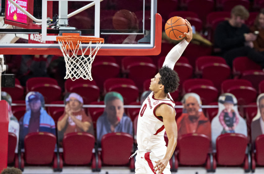FAYETTEVILLE, AR - NOVEMBER 25: Justin Smith #0 of the Arkansas Razorbacks goes up for a shot in the first half of a game against the Mississippi State Valley Delta Devils at Bud Walton Arena on November 25, 2020 in Fayetteville, Arkansas. (Photo by Wesley Hitt/Getty Images)