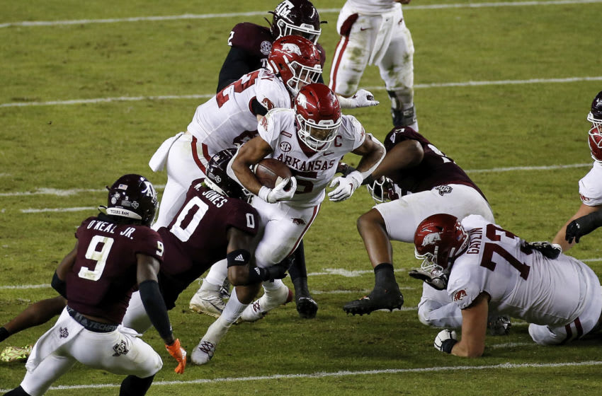 COLLEGE STATION, TEXAS - OCTOBER 31: Rakeem Boyd #5 of the Arkansas Razorbacks is tackled by Myles Jones #0 of the Texas A&M Aggies in the third quarter at Kyle Field on October 31, 2020 in College Station, Texas. (Photo by Tim Warner/Getty Images)