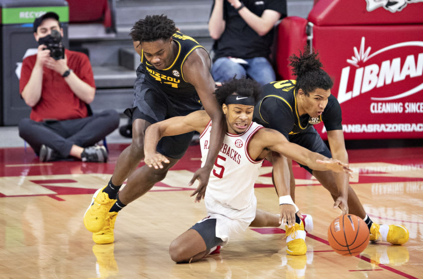 FAYETTEVILLE, ARKANSAS - JANUARY 02: Kobe Brown #24 and Dru Smith #12 of the Missouri Tigers fight for a loss ball in the first half against Moses Moody #5 of the Arkansas Razorbacks at Bud Walton Arena on January 02, 2021 in Fayetteville, Arkansas. (Photo by Wesley Hitt/Getty Images)