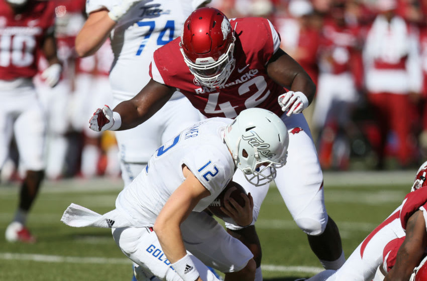 Oct 20, 2018; Fayetteville, AR, USA; Tulsa Golden Hurricane quarterback Seth Boomer (12) is tackled by Arkansas Razorbacks defensive lineman Jonathan Marshall (42) at Donald W. Reynolds Razorback Stadium. Arkansas won 23-0. Mandatory Credit: Nelson Chenault-USA TODAY Sports