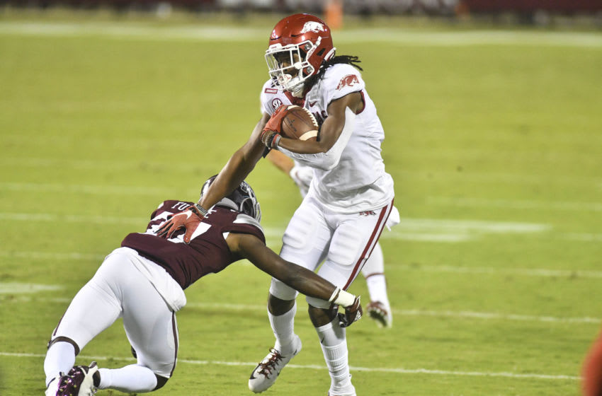 Oct 3, 2020; Starkville, Mississippi, USA; Arkansas Razorbacks wide receiver Trey Knox (7) carries the ball while defended by Mississippi State Bulldogs cornerback Esaias Furdge (27) during the second quarter at Davis Wade Stadium at Scott Field. Mandatory Credit: Matt Bush-USA TODAY Sports