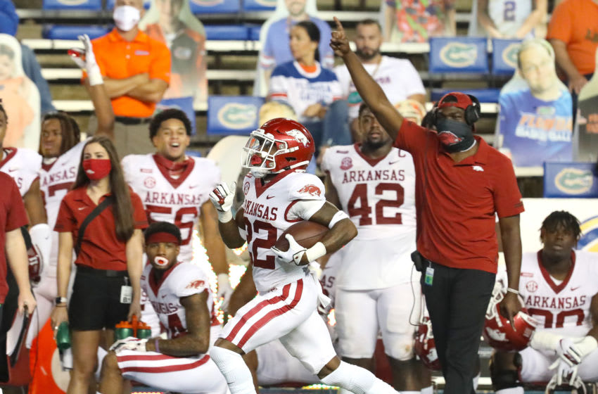 Nov 14, 2020; Gainesville, FL, USA; Arkansas Razorbacks running back Trelon Smith (22) scores a touchdown during a football game against Florida at Ben Hill Griffin Stadium. Mandatory Credit: Brad McClenny-USA TODAY NETWORK