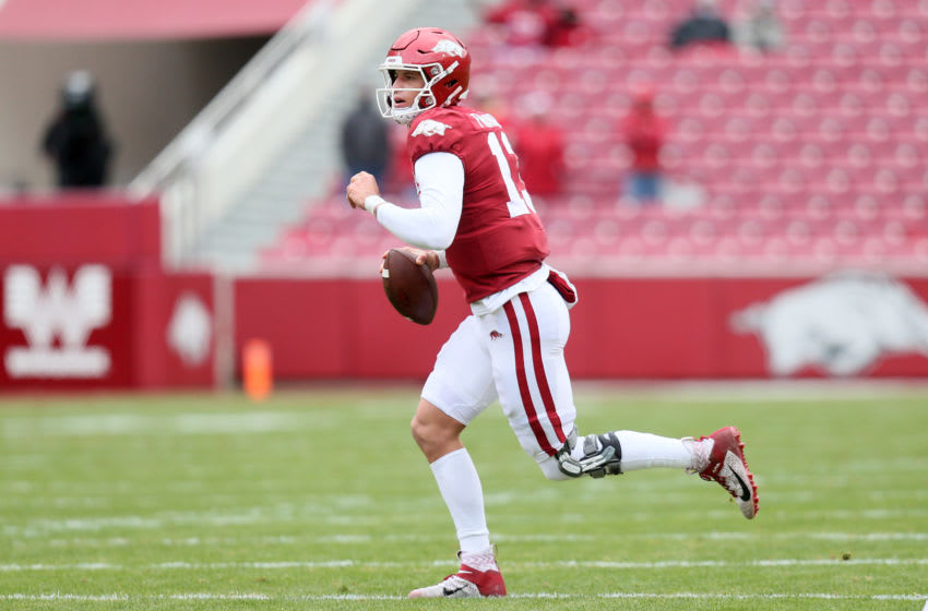 Dec 12, 2020; Fayetteville, Arkansas, USA; Arkansas Razorbacks quarterback Feleipe Franks (13) rolls out to pass against the Alabama Crimson Tide in the first quarter at Donald W. Reynolds Razorback Stadium. Mandatory Credit: Nelson Chenault-USA TODAY Sports