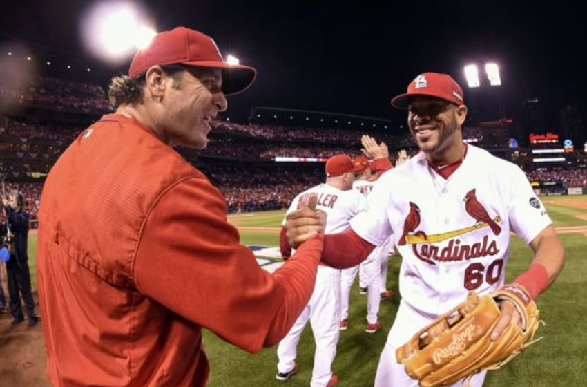 Oct 9, 2015; St. Louis, MO, USA; St. Louis Cardinals outfielder Tommy Pham (60) is congratulated by manager Mike Matheny (22) after the game against the Chicago Cubs in game one of the NLDS at Busch Stadium. Mandatory Credit: Scott Rovak-USA TODAY Sports