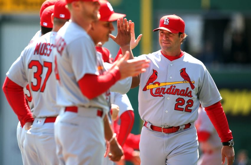 Apr 3, 2016; Pittsburgh, PA, USA; St. Louis Cardinals manager Mike Matheny (22) high-fives his team during player introductions before playing the Pittsburgh Pirates at PNC Park. Mandatory Credit: Charles LeClaire-USA TODAY Sports