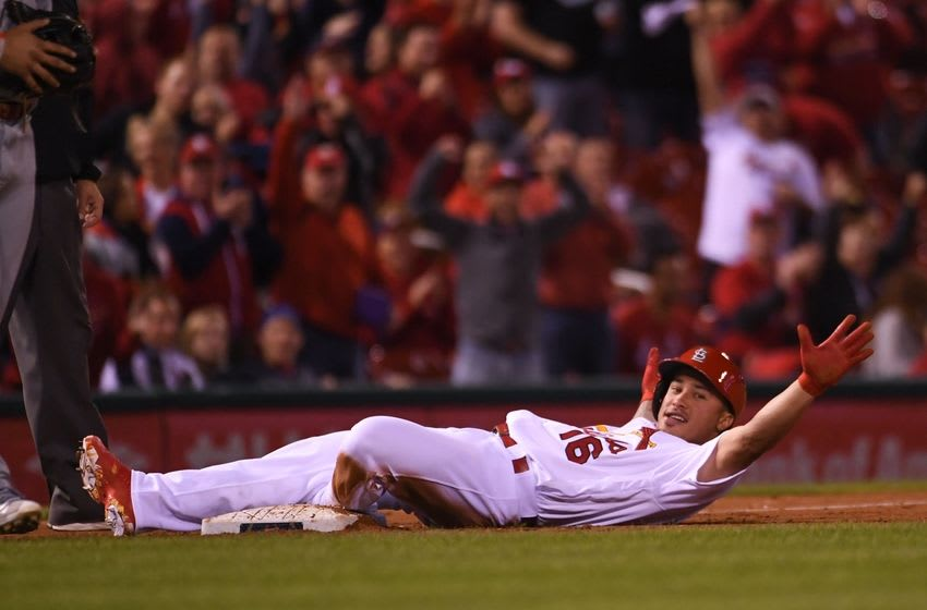 Sep 28, 2016; St. Louis, MO, USA; St. Louis Cardinals pinch hitter Kolten Wong (16) looks to the Cardinals dugout as he slides safely into third base with a triple against the Cincinnati Reds at Busch Stadium. Mandatory Credit: Scott Rovak-USA TODAY Sports