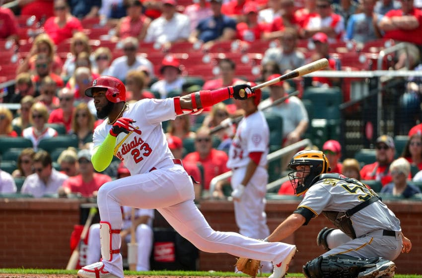 ST LOUIS, MO - SEPTEMBER 12: Marcell Ozuna #23 of the St. Louis Cardinals hits an RBI single during the first inning against the Pittsburgh Pirates at Busch Stadium on September 12, 2018 in St Louis, Missouri. (Photo by Jeff Curry/Getty Images)
