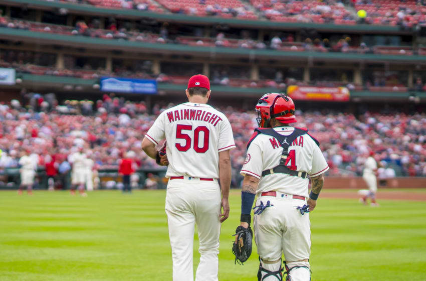 ST. LOUIS, MO - SEPTEMBER 22: Yadier Molina #4 and Adam Wainwright #50 of the St. Louis Cardinals walk from the bullpen to the home dugout prior to the start of the game against the San Francisco Giants on September 22, 2018 at Busch Stadium in St. Louis, Missouri. (Photo by Taka Yanagimoto/St. Louis Cardinals/Getty Images)