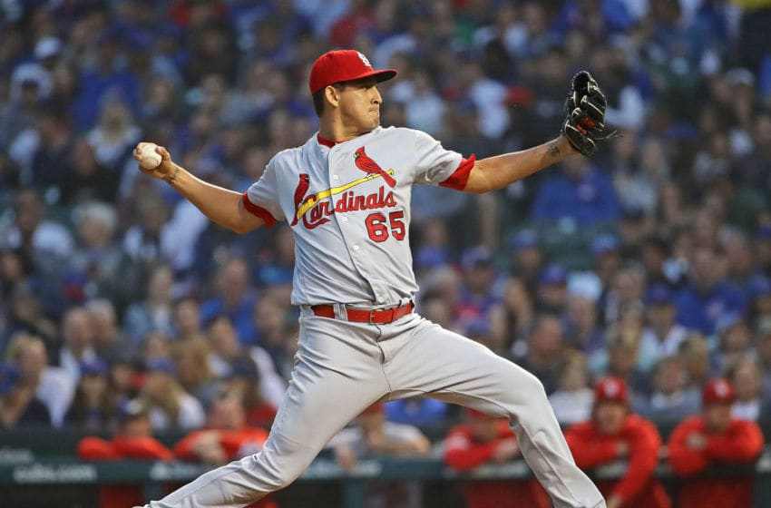 CHICAGO, ILLINOIS - JUNE 09: Giovanny Gallegos #65 of the St. Louis Cardinals pitches against the Chicago Cubs at Wrigley Field on June 09, 2019 in Chicago, Illinois. (Photo by Jonathan Daniel/Getty Images)