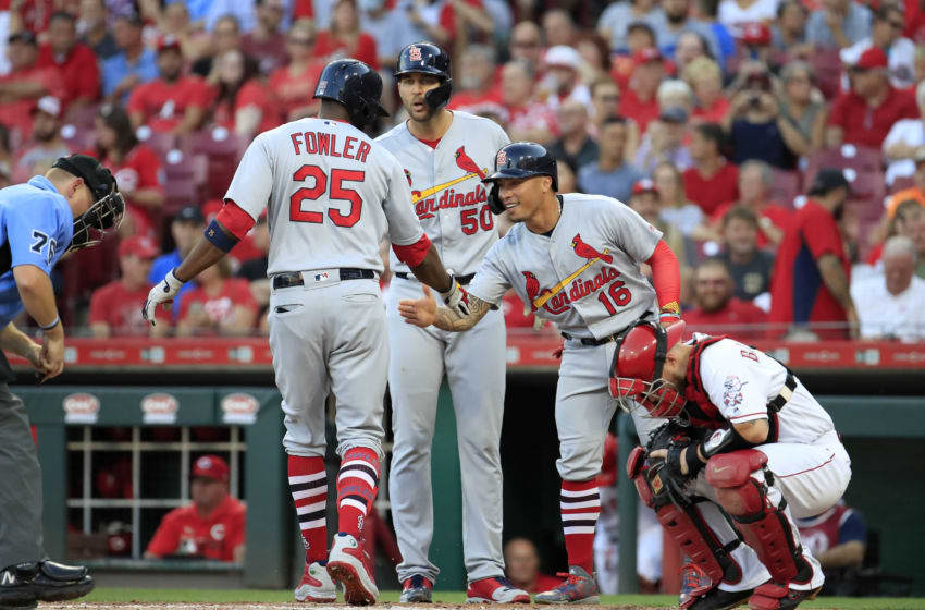 CINCINNATI, OHIO - AUGUST 16: Dexter Fowler #25 of the St. Louis Cardinals is congratulated by Adam Wainwright #50 and Kolten Wong #16 after hitting a three run home run in the second inning against the Cincinnati Reds at Great American Ball Park on August 16, 2019 in Cincinnati, Ohio. (Photo by Andy Lyons/Getty Images)