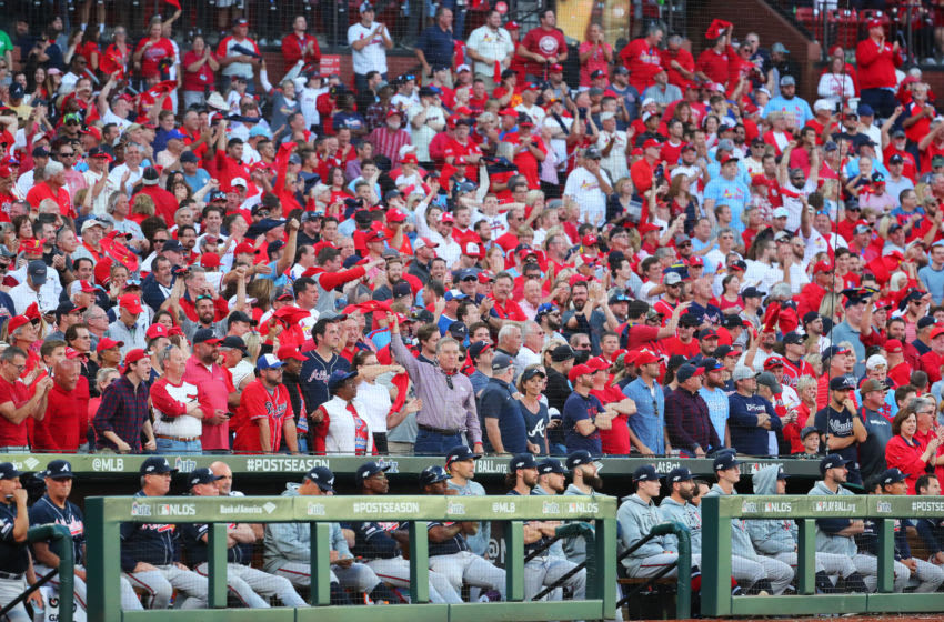 ST. LOUIS, MO - OCTOBER 07: Cardinals fans cheer behind the Atlanta Braves dugout after the score is tied in the eighth inning during Game 4 of the NLDS between the Atlanta Braves and the St. Louis Cardinals at Busch Stadium on Monday, October 7, 2019 in St. Louis, Missouri. (Photo by Dilip Vishwanat/MLB Photos via Getty Images)