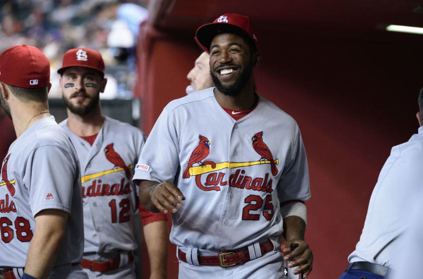 PHOENIX, ARIZONA - SEPTEMBER 25: Dexter Fowler #25 of the St. Louis Cardinals smiles in the dugout during the MLB game against the Arizona Diamondbacks at Chase Field on September 25, 2019 in Phoenix, Arizona. The Arizona Diamondbacks won 9 to 7. (Photo by Jennifer Stewart/Getty Images)