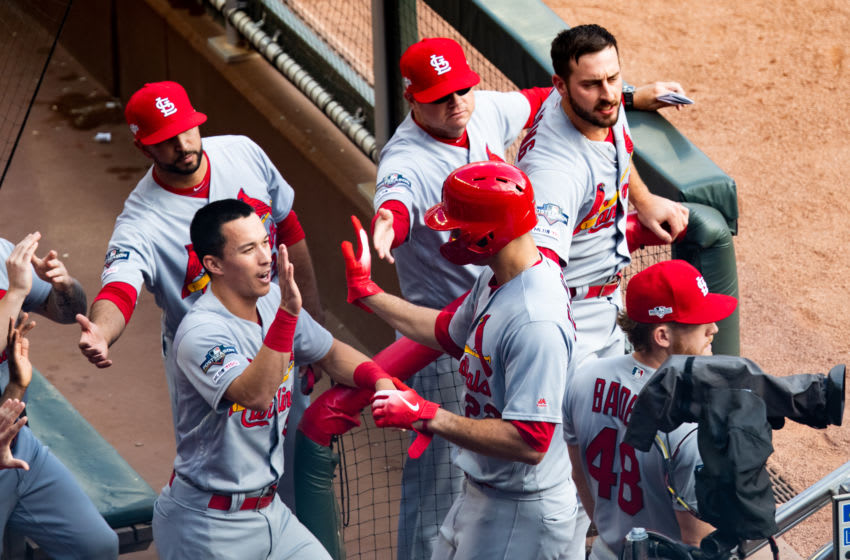 ATLANTA, GA - OCTOBER 09: Jack Flaherty #22 of the St. Louis Cardinals high fives teammates in the dugout during Game Five of the National League Division Series against the Atlanta Braves at SunTrust Park on October 9, 2019 in Atlanta, Georgia. (Photo by Carmen Mandato/Getty Images)