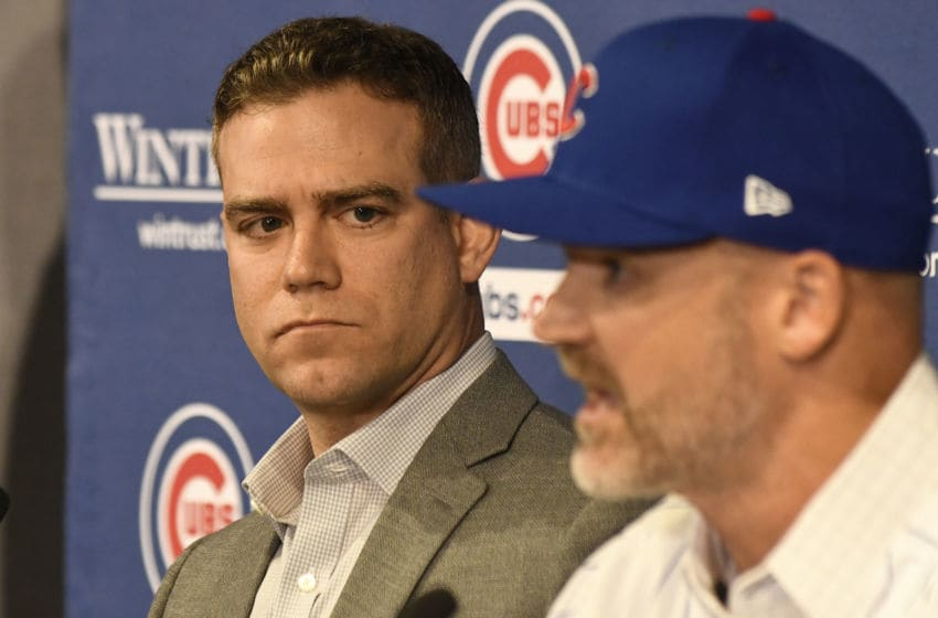 CHICAGO, ILLINOIS - OCTOBER 28: Theo Epstein, president of baseball operations of the Chicago Cubs (L) looks on as David Ross, new manager of the Chicago Cubs (R) talks to the to the media during a press conference at Wrigley Field on October 28, 2019 in Chicago, Illinois. (Photo by David Banks/Getty Images)