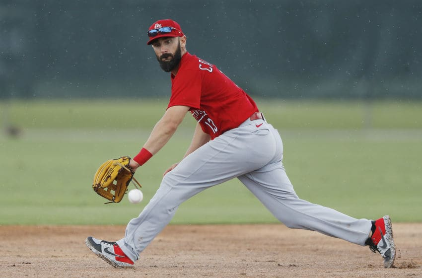 JUPITER, FLORIDA - FEBRUARY 19: Matt Carpenter #13 of the St. Louis Cardinals fields a ground ball during a team workout at Roger Dean Chevrolet Stadium on February 19, 2020 in Jupiter, Florida. (Photo by Michael Reaves/Getty Images)