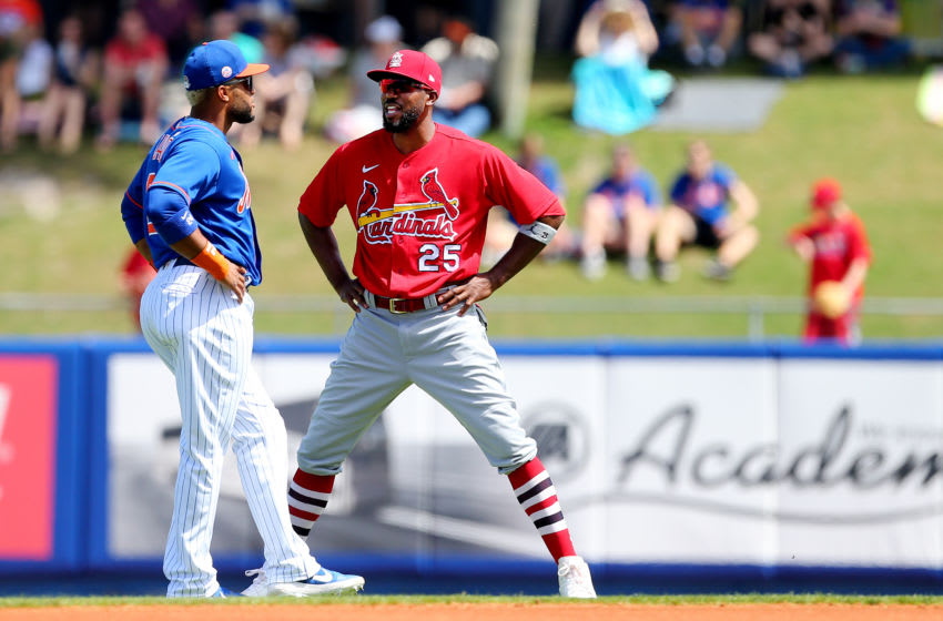 PORT ST. LUCIE, FL - MARCH 11: Robinson Cano #24 of the New York Mets and Dexter Fowler #25 of the St. Louis Cardinals before a spring training baseball game at Clover Park at on March 11, 2020 in Port St. Lucie, Florida. (Photo by Rich Schultz/Getty Images)