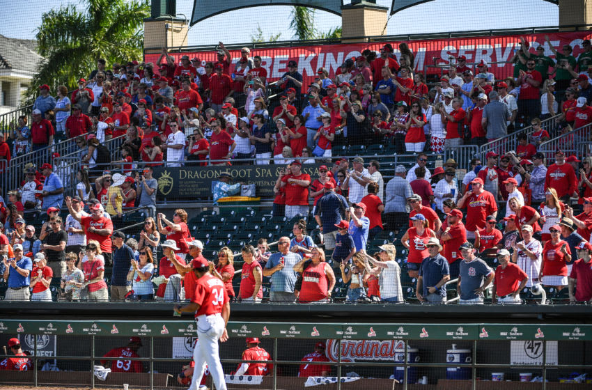 JUPITER, FLORIDA - MARCH 12: St. Louis Cardinals fans cheer after the spring training game against the Miami Marlins at Roger Dean Chevrolet Stadium on March 12, 2020 in Jupiter, Florida. Major League Baseball is suspending Spring Training and the first two weeks of the regular season due to the ongoing threat of the Coronavirus (COVID-19) outbreak. (Photo by Mark Brown/Getty Images)