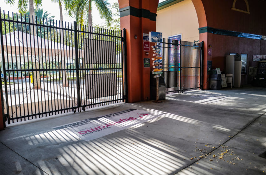 JUPITER, FLORIDA - MARCH 12: A general view of the closed gates at the stadium after the spring training game between the St. Louis Cardinals and the Miami Marlins at Roger Dean Chevrolet Stadium on March 12, 2020 in Jupiter, Florida. Major League Baseball is suspending Spring Training and delaying the start of the regular season by at least two weeks due to the ongoing threat of the Coronavirus (COVID-19) outbreak. (Photo by Mark Brown/Getty Images)