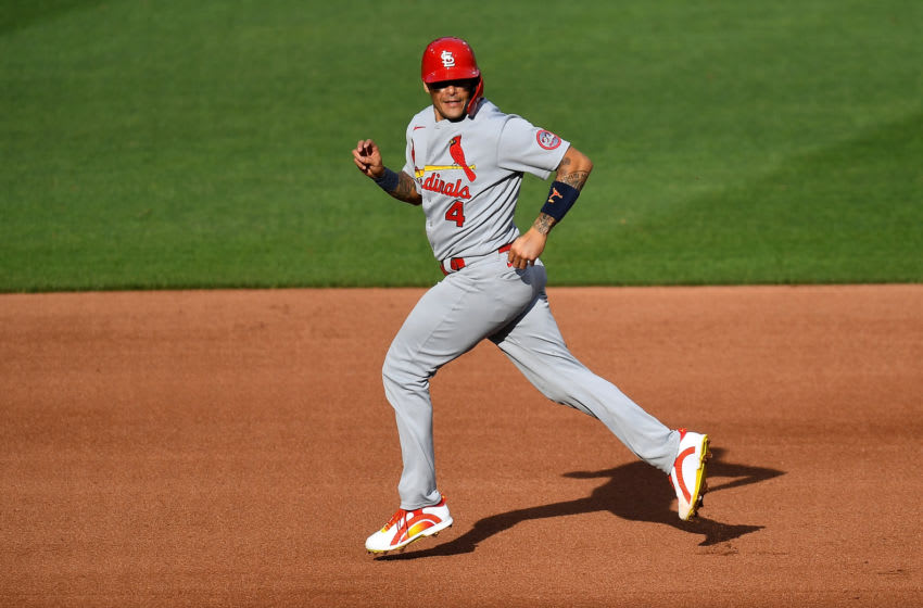 Yadier Molina #4 of the St. Louis Cardinals runs to third base after a bobbled double play attempt during the fourth inning against the Pittsburgh Pirates of game one of a doubleheader at PNC Park on September 18, 2020 in Pittsburgh, Pennsylvania. (Photo by Joe Sargent/Getty Images)