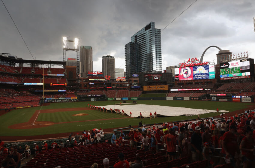 ST LOUIS, MO - JUNE 27: The grounds crew pulls a tarp over the infield prior to a thunderstorm delaying a game between the St. Louis Cardinals and the Pittsburgh Pirates at Busch Stadium on June 27, 2021 in St Louis, Missouri. (Photo by Dilip Vishwanat/Getty Images)