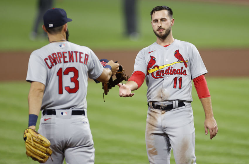 CINCINNATI, OH - SEPTEMBER 01: Paul DeJong #11 of the St Louis Cardinals receives his cap and glove from teammate Matt Carpenter #13 during a game against the Cincinnati Reds at Great American Ball Park on September 1, 2020 in Cincinnati, Ohio. The Cardinals defeated the Reds 16-2. (Photo by Joe Robbins/Getty Images)