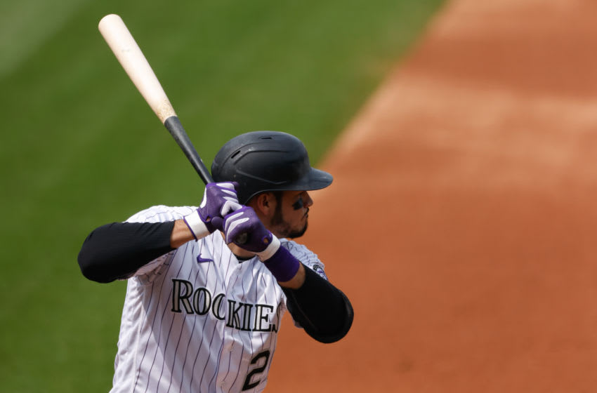 Nolan Arenado #28 of the Colorado Rockies bats during the second inning against the Oakland Athletics at Coors Field on September 16, 2020 in Denver, Colorado. (Photo by Justin Edmonds/Getty Images)