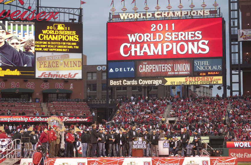 ST. LOUIS, MO - OCTOBER 30: Third baseman David Freese of the St. Louis Cardinals takes the podium during the World Series victory parade inside Busch Stadium on October 30, 2011 in St Louis, Missouri. (Photo by Ed Szczepanski/Getty Images)