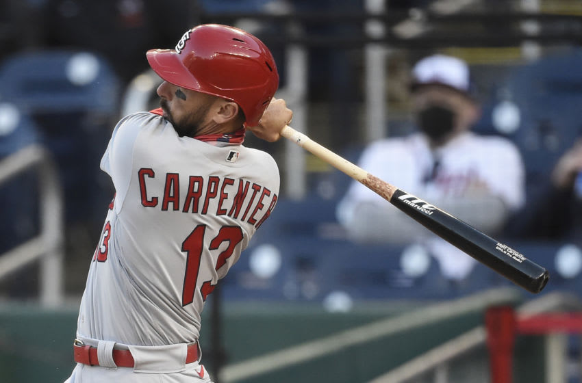 WASHINGTON, DC - APRIL 21: Matt Carpenter #13 of the St. Louis Cardinals hits a fly ball out to right field in the eighth inning against the Washington Nationals at Nationals Park on April 21, 2021 in Washington, DC. (Photo by Patrick McDermott/Getty Images)