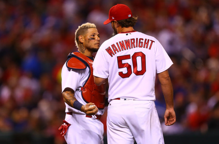 Yadier Molina #4 and starter Adam Wainwright #50 of the St. Louis Cardinals talk in between pitches against the Chicago Cubs in the fifth inning at Busch Stadium on April 4, 2017 in St. Louis, Missouri. (Photo by Dilip Vishwanat/Getty Images)
