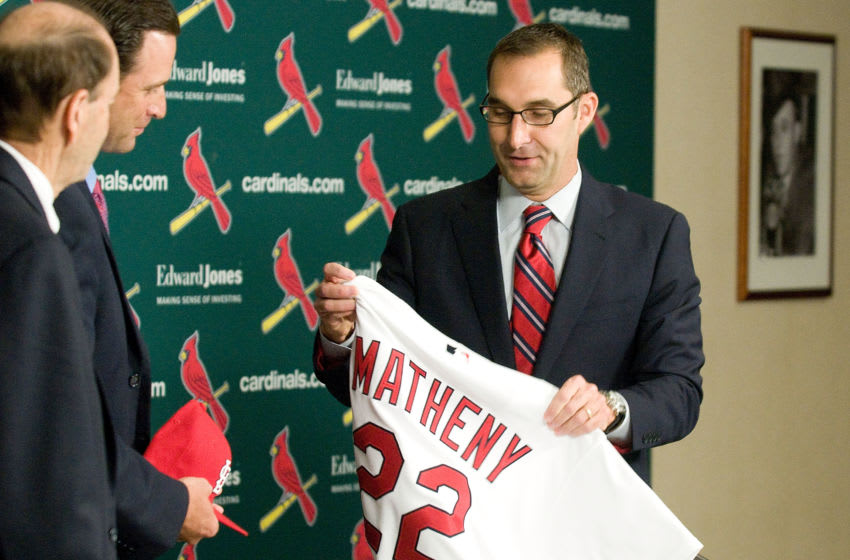ST. LOUIS, MO - NOVEMBER 14: St. Louis Cardinals general manager John Mozeliak (R) introduces Mike Matheny as the new manager during a press conference at Busch Stadium on November 14, 2011 in St. Louis, Missouri. (Photo by Jeff Curry/Getty Images)