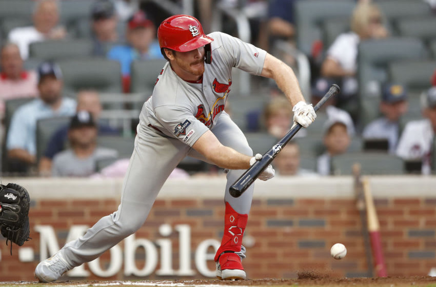 ATLANTA, GEORGIA - OCTOBER 03: Miles Mikolas #39 of the St. Louis Cardinals hits a sacrifice bunt against the Atlanta Braves during the fifth inning in game one of the National League Division Series at SunTrust Park on October 03, 2019 in Atlanta, Georgia. (Photo by Todd Kirkland/Getty Images)