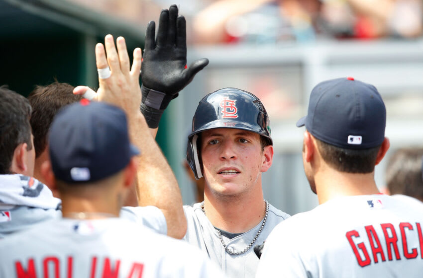 PITTSBURGH - JULY 24: Colby Rasmus #28 of the St Louis Cardinals is congratulated by teammates in the dugout after hitting a solo home run against the Pittsburgh Pirates during the game on July 24, 2011 at PNC Park in Pittsburgh, Pennsylvania. (Photo by Jared Wickerham/Getty Images)