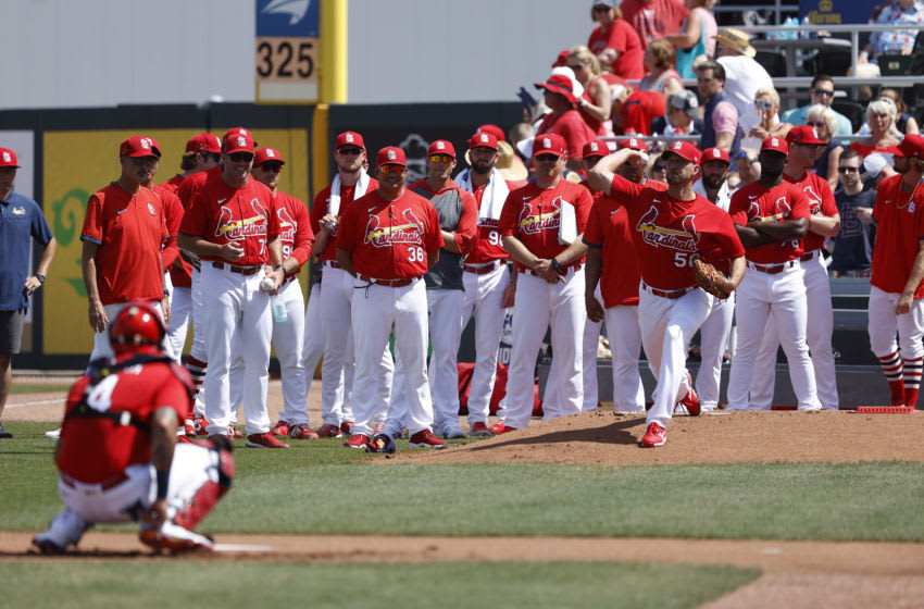 JUPITER, FL - MARCH 05: Adam Wainwright #50 of the St Louis Cardinals warms up as a large group of teammates watch prior to a Grapefruit League spring training game against the New York Mets at Roger Dean Stadium on March 5, 2020 in Jupiter, Florida. The game ended in a 7-7 tie. (Photo by Joe Robbins/Getty Images)