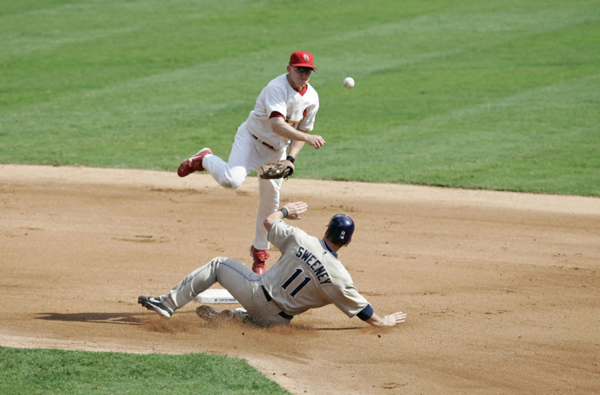 David Eckstein of the St. Louis Cardinals completes a double play against the San Diego Padres during Game 1 of the National League Divisional Playoffs held at Busch Stadium in St. Louis, Missouri on October 4, 2005. The Cardinals won 8-5. (Photo by G. N. Lowrance/Getty Images)