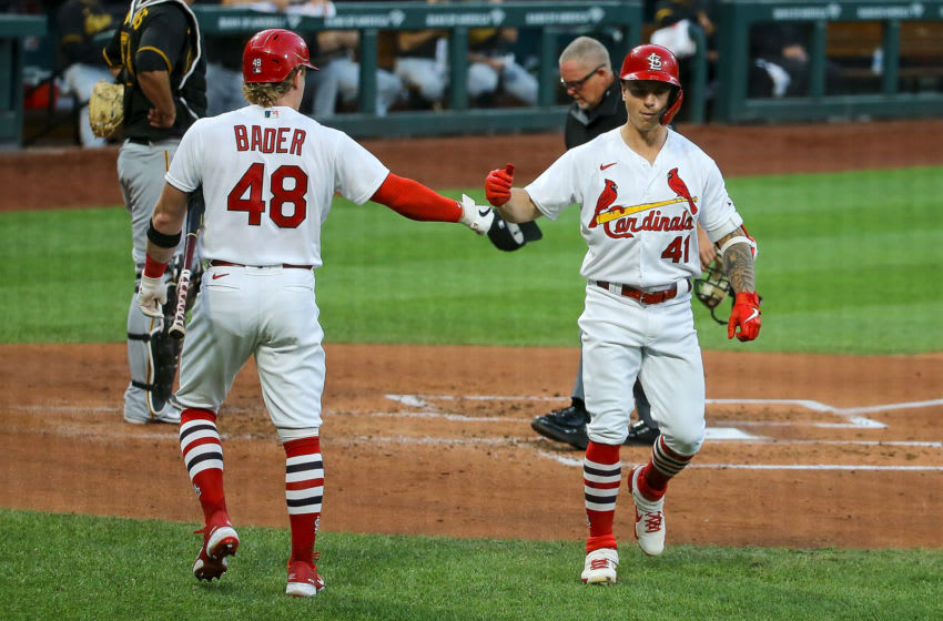 ST. LOUIS, MO - JULY 24: Tyler O'Neill #41 of the St. Louis Cardinals is congratulated by Harrison Bader #48 after hitting a solo home run during the third inning of the Opening Day game against the Pittsburgh Pirates at Busch Stadium on July 24, 2020 in St. Louis, Missouri. The 2020 season had been postponed since March due to the COVID-19 pandemic. (Photo by Scott Kane/Getty Images)