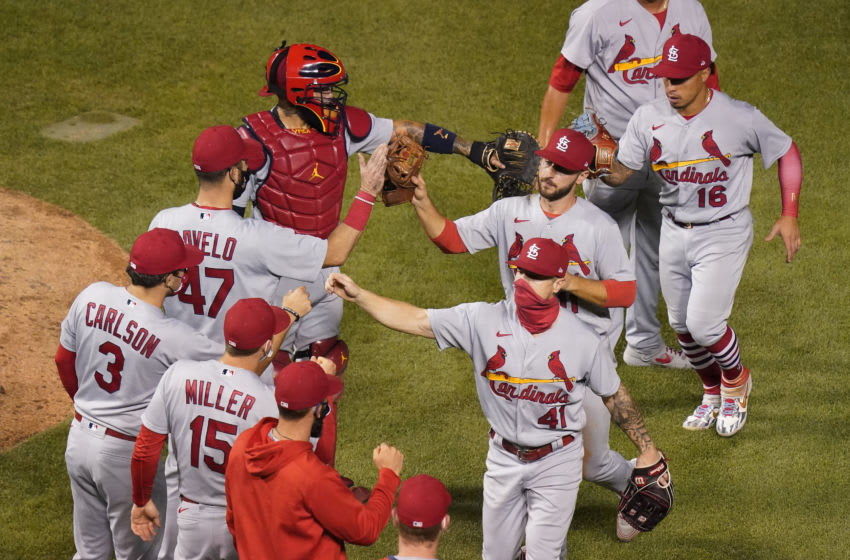 CHICAGO, ILLINOIS - SEPTEMBER 06: St. Louis Cardinals players celebrate their team's 7-3 win over the Chicago Cubs at Wrigley Field on September 06, 2020 in Chicago, Illinois. (Photo by Nuccio DiNuzzo/Getty Images)