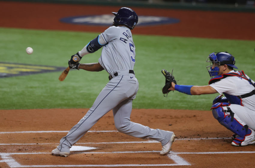 ARLINGTON, TEXAS - OCTOBER 27: Randy Arozarena #56 of the Tampa Bay Rays hits a solo home run against the Los Angeles Dodgers during the first inning in Game Six of the 2020 MLB World Series at Globe Life Field on October 27, 2020 in Arlington, Texas. (Photo by Ronald Martinez/Getty Images)