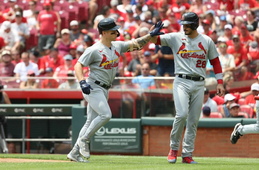 CINCINNATI, OHIO - JULY 25: Tyler O'Neil #27 of the St. Louis celebrates with Nolan Arenado #28 hits a two RBI homerun in the first inning against the Cincinnati Reds at Great American Ball Park on July 25, 2021 in Cincinnati, Ohio. (Photo by Andy Lyons/Getty Images)